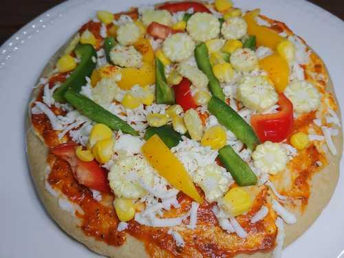 adding veggies to pizza recipe